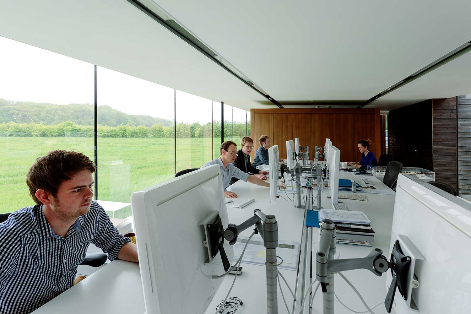 Modern office with 5 employees working - Blog Image 2018.jpg